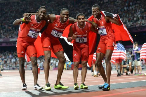 Photo: Trinidad and Tobago 4x400 metre relay team (from left) Jarrin Solomon, Lalonde Gordon, Ade Alleyne-Forte and Deon Lendore celebrate their third place finish at the London 2012 Olympic Games on 10 August 2012. (Copyright AFP 2017/Eric Feferberg)