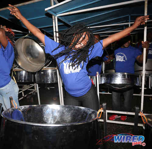 "Photo: Simple Song Steel Orchestra pannist, Makeda, dances during their rendition of ""Rebecca."" (Courtesy Annalicia Caruth/Wired868)"