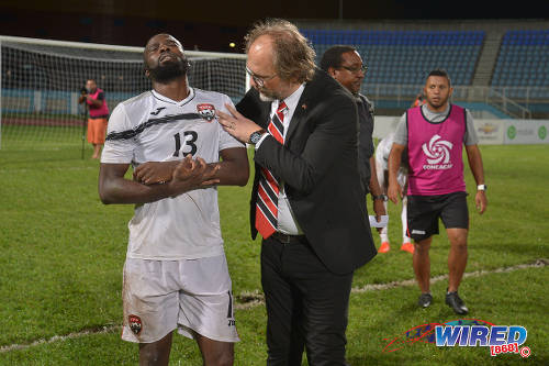 Photo: Trinidad and Tobago forward Cornell Glen (left) nurses his broken arm while head coach Tom Saintfiet looks on after their Gold Cup qualifying loss against Haiti on 8 January 2017. (Courtesy Chevaughn Christopher/Wired868)