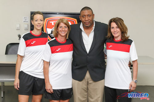 Photo: Trinidad and Tobago Football Association (TTFA) president David John-Williams (second from right) poses with Women's National Senior Team coaches (from left) Nicola Williams, Carolina Morace and Elisabetta Bavagnoli at a press conference in the Ato Boldon Stadium, Couva on 1 February 2017. (Courtesy Sean Morrison/Wired868)