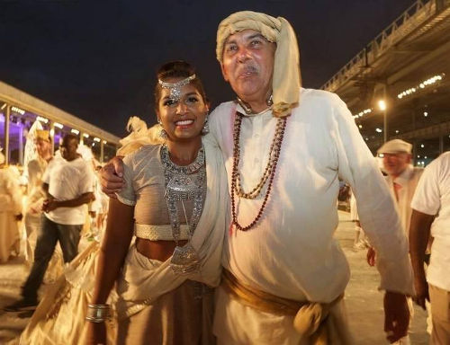 Photo: President Anthony Carmona (right) and his wife Reema enjoy their Carnival in Brian MacFarlane's 2017 presentation entitled Cazabon—The Art of Living. Carmona, who wore white dhoti, kurta, turban and beads, played in the section called Apna Desh. (Copyright Trinidad Express)