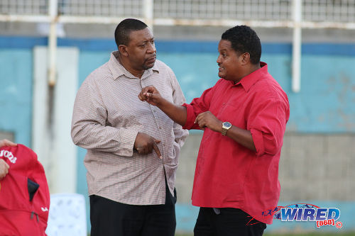 Photo: Sport Minister Darryl Smith (right) makes a point to Trinidad and Tobago Football Association (TTFA) president David John-Williams after women's international friendly action against Venezuela at the Ato Boldon Stadium in Couva on 26 March 2017. (Courtesy Chevaughn Christopher/Wired868)