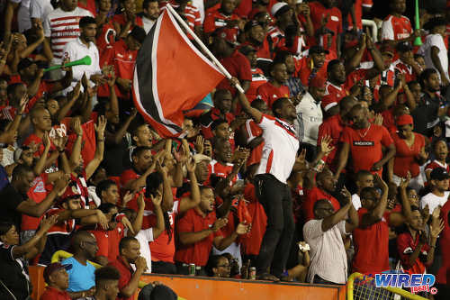 Photo: Trinidad and Tobago football fans enjoy the show during 2018 World Cup qualifying action at the Hasely Crawford Stadium on 24 March 2017. (Courtesy Chevaughn Christopher/Wired868)