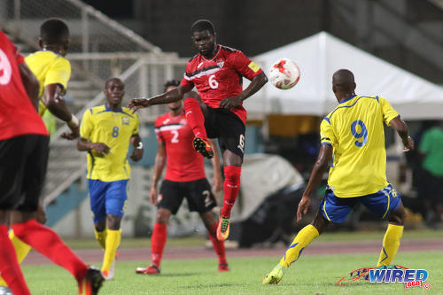 Photo: Trinidad and Tobago midfielder Hughtun Hector (centre) executes a volleyed pass during international friendly action against Barbados at the Ato Boldon Stadium in Couva on 10 March 2017. (Courtesy Chevaughn Christopher/Wired868)