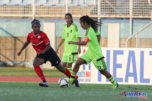 Photo: Trinidad and Tobago midfielder Mia Walcott (left) tries to keep an eye on Venezuela playmaker and captain Paola Villamizar during international friendly action at the Ato Boldon Stadium in Couva on 26 May 2017. (Courtesy Chevaughn Christopher/Wired868)