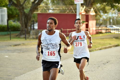 Photo: Two fleet footed runners challenge each other during the COSTAATT 5K on Sunday 2 April 2017. (Copyright Andre Cadogan/COSTAATT)