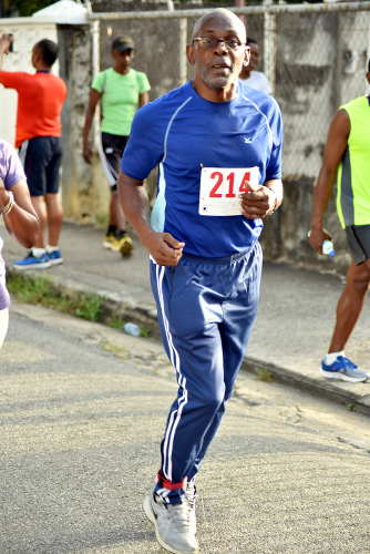 Photo: Wired868 editor and retired lecturer Earl Best, who made the mistake of attempting to complete the 2017 COSTAATT 5K without having properly trained for it. (Copyright Andre Cadogan/COSTAATT)