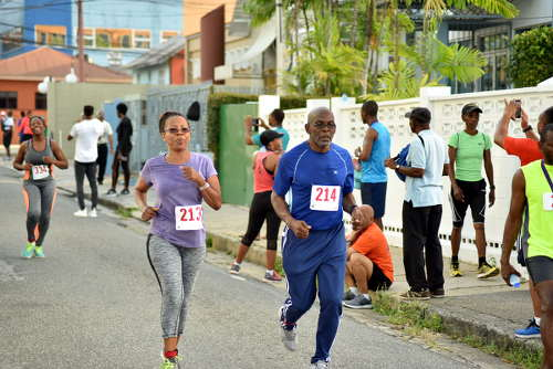 Photo: Wired868 editor and retired lecturer Earl Best (right) runs alongside his wife Lilian Best at the COSTAATT 5K on Sunday 2 April 2017. (Copyright Andre Cadogan/COSTAATT)