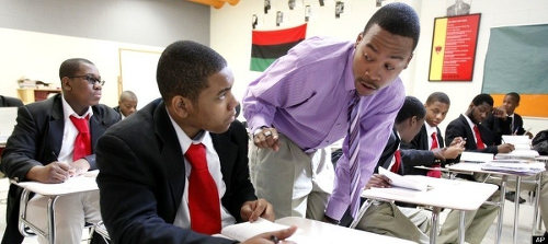 Photo: A teacher (right) interacts with his student at class. (Copyright Raa Network)