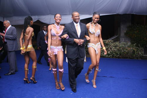 Photo: Chief Justice Ivor Archie (centre) is escorted to the podium by two models during the Inaugural Conference of the Caribbean Association of Judicial Officers in June 2009. (Copyright News.gov.tt)