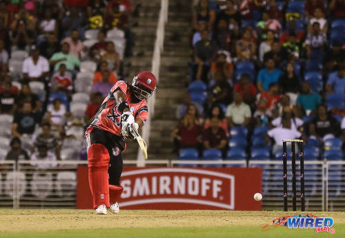 Photo: West Indies cricket legend Brian Lara goes on the attack during an exhibition match at the opening of the Brian Lara Cricket Stadium in Tarouba on 12 May 2017. (Courtesy Sean Morrison/Wired868)