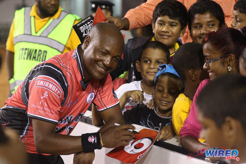 Photo: West Indies cricket icon Brian Lara (left) signs autographs during the opening of the Brian Lara Cricket Stadium in Tarouba on 12 May 2017. (Courtesy Sean Morrison/Wired868)