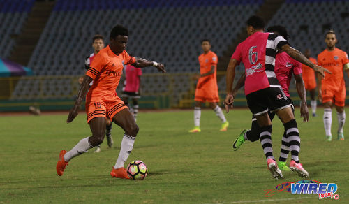 Photo: Cibao FC winger Patrick Soko (left) takes on Central FC full back Carlos Edwards during 2017 Caribbean Club Championship action at the Hasely Crawford Stadium on 18 May 2017. Soko scored the winner as Cibao edged Central for a place in the regional final. (Courtesy Sean Morrison/Wired868)
