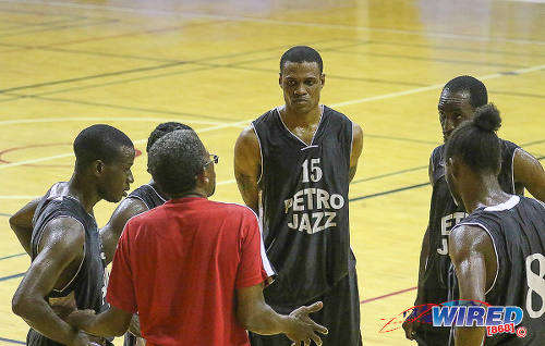 Photo: Members of the Petro Jazz basketball team have a mid-game chat. (Courtesy Sean Morrison/Wired868)