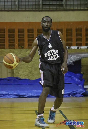 Photo: A Petro Jazz player in action during a local basketball competition. (Courtesy Sean Morrison/Wired868)