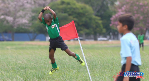 Photo: Harvard SC attacker Josh Miguel (left) mimics Real Madrid and Portugal superstar Cristiano Ronaldo as he celebrates his goal against QPCC during RBNYL North Zone U-11 action at the Queen's Park Savannah in Port of Spain on 27 May 2017. (Courtesy Sean Morrison/Wired868)