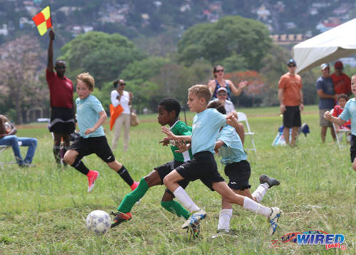 Photo: A flag from the referee's assistant (far left) thwarts Harvard SC attacker Mikel John as he closes in on the QPCC '2' goal during RBNYL North Zone U-11 action at the Queen's Park Savannah in Port of Spain on 27 May 2017. (Courtesy Sean Morrison/Wired868)
