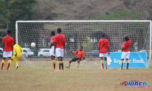 Photo: Laventille United goalkeeper Josiah Coy (second from left) beats Trendsetter Hawks custodian Jaheim Morris from the penalty spot during RBNYL Under-15 action against Eastern United at the Queen's Park Savannah on 15 May 2017. It was the lone highlight for Laventille who lost 11-1. (Courtesy Nicholas Bhajan/Wired868)