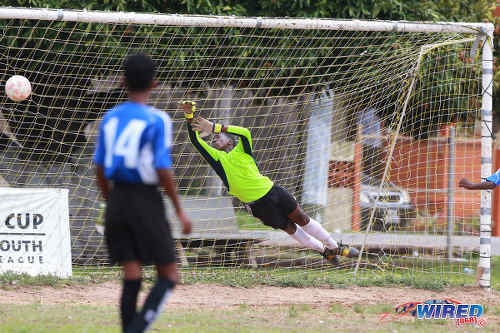 Photo: Club Sando's Under-13 goalkeeper makes a vain attempt to reach a shot during RBNYL action against Petrotrin Palo Seco SA in La Brea on 21 May 2017. Palo Seco won 2-0. (Courtesy Allan V Crane/Wired868)