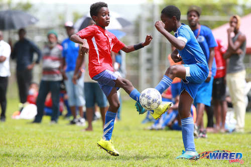 Photo: Ste Madeleine Strikers player Malique King (right) and San Fernando SA player Asime Walker contest the ball during RBNYL action in La Brea on 21 May 2017. (Courtesy Allan V Crane/Wired868)