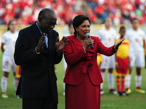 Photo: Ex-FIFA vice-president Jack Warner (left) and former Prime Minister Kamla Persad-Bissessar share a light moment during the 2010 FIFA Under-17 Women's World Cup in Trinidad and Tobago. (Courtesy FIFA.com)