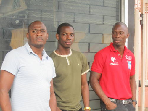 "Photo: 2006 World Cup players (from left to right) Cyd Gray, Anthony Wolfe and David Atiba Charles lead raid on the TTFF. (Courtesy Patricia ""Brownsugar"" Smart)"