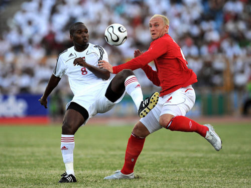 Photo: Trinidad and Tobago midfielder Khaleem Hyland (left) holds off former England striker Dean Ashton during an international friendly on 4 May 2008 in Port of Spain. Hyland has spent his last seven years as a professional player in Belgium.