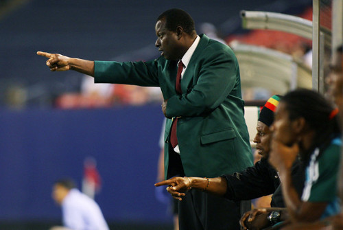 Photo: DIRECTV W Connection coach Stuart Charles-Fevrier (standing) points the way for his troops. At his side is current Trinidad and Tobago National Under-20 coach Brian Williams.