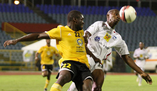 Photo: Caledonia AIA striker Jamal Gay (right) tries to hold off T&TEC's Kerlon Ferguson during a mid-season battle