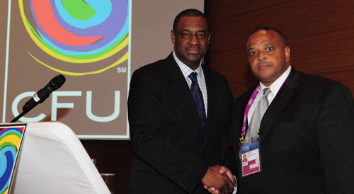 Photo: CONCACAF President Jeffrey Webb (left) congratulates freshly minted CFU President Gordon Derrick. Derrick was charged for his role in the Mohamed Bin Hammam bribery scandal while Webb is wanted by the FBI for racketeering.