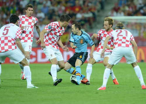 Photo: Spain midfield star and World Cup, Euro Cup and Champions League winner Andrés Iniesta (centre) bewitches half the Croatian team during the Euro 2012 competition. Iniesta's first major tournament was at the Trinidad and Tobago 2001 Under-17 World Cup where he played at the Mannie Ramjohn Stadium.