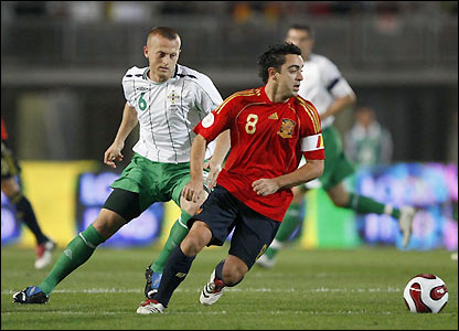 Photo: Xavi (right) is the heartbeat of a gifted Spanish midfield.