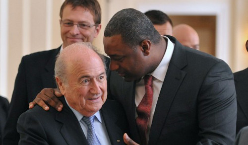 Photo: Former CONCACAF president Jeff Webb (right) has a word with suspended FIFA president Sepp Blatter. Webb was charged with several counts of racketeering and money laundering by the United States Department of Justice while Blatter was suspended over a disloyalty payment to suspended UEFA president Michel Platini.
