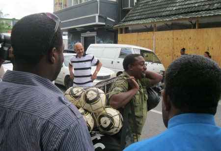 "Photo: Caledonia AIA and Guyana national football coach Jamaal Shabazz (centre) is allowed to leave with a bag of balls during the Soca Warriors' levy on the TTFF headquarters in 2012. Looking on (in the background) is current Sport Ministry advisor Kevin Harrison. (Courtesy Patricia ""Brown Sugar"" Smart)"