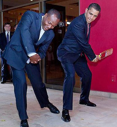 Photo: Trinidad and Tobago sport icon Brian Lara gives cricket tips to United States president and sport enthusiast Barack Obama. (Courtesy cricketrediff.com)