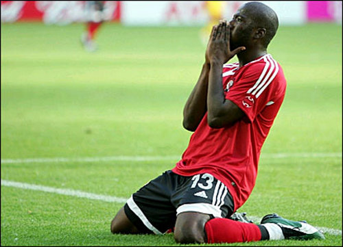 Photo: Trinidad and Tobago striker Cornell Glen collects his thoughts after striking the bar against Sweden during the Germany 2006 World Cup. (Courtesy www.bbc.co.uk)