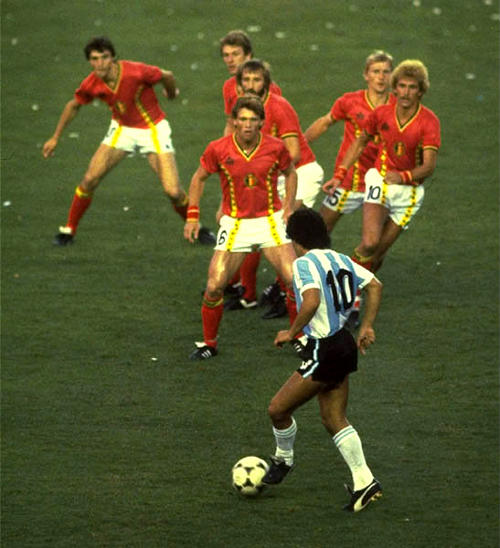 Photo: Argentine legend Diego Maradona puts half the Belgium team in a trance in this iconic World Cup photo.