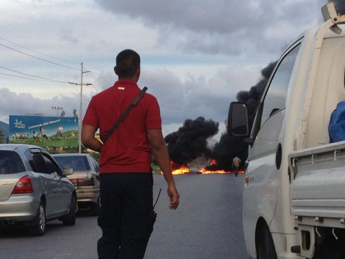 Photo: A fiery protest on the highway outside the Beetham Gardens.