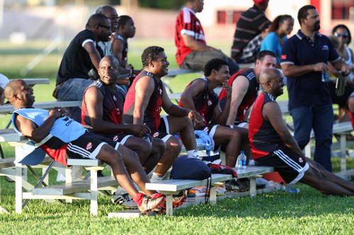 Photo: (From left to right) Calvin Pierre, Hutson Charles, Anton Corneal, Sherdon Pierre, Lasana Liburd, Terry Fenwick and Roger Ekow Watts enjoy the action from the sidelines during the inaugural Wired868 Football Festival at UWI SPEC in 2013. (Courtesy Allan V. Crane/Wired868.com)
