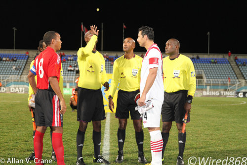Photo: Trinidad and Tobago captain Densill Theobald (left) and Peru captain Claudio Pizarro await Barbadian referee Adrian Skeete's coin toss. (Courtesy Allan V. Crane/ Wired868)