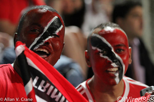 Photo: Two Trinidad and Tobago football fans found plenty to get excited about. (Courtesy Allan V. Crane/ Wired868)