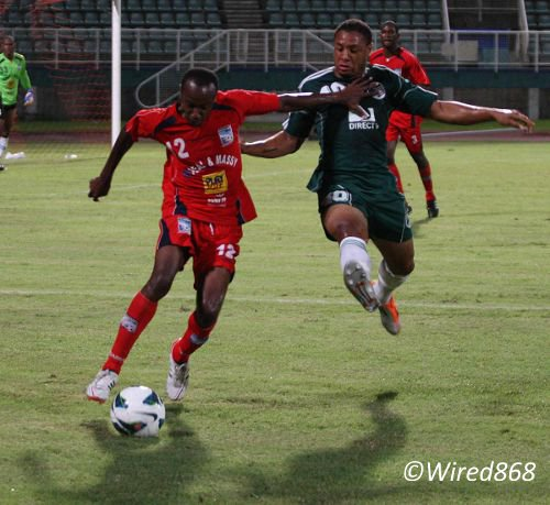 Photo: Caledonia AIA right back Kareem Joseph (left) shoots past ex-W Connection attacker Shahdon Winchester. Joseph  is arguably the Pro League's best right back. (Courtesy Wired868)