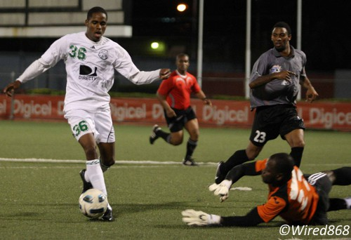Photo: W Connection star Joevin Jones (left) dribbles around his former club and international captain and now St Ann's Rangers goalkeeper Jan-Michael Williams. (Courtesy Wired868)