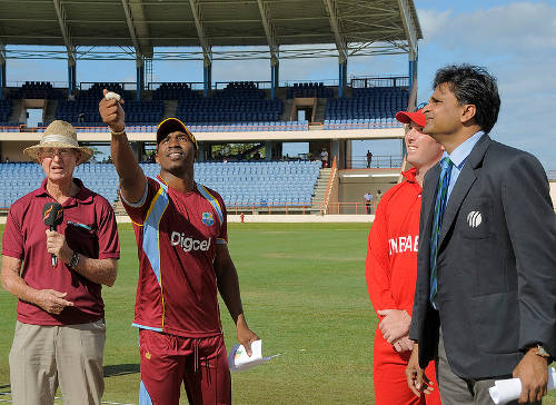 Photo: Dwayne Bravo (second from left) takes the toss for the West Indies. (Courtesy WICB)