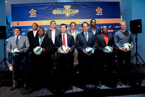 Photo: Trinidad and Tobago co-head coach Hutson Charles (second from right) poses alongside United States coach and Germany World Cup winner Jurgen Klinsmann (far right) and the coaches from the other 10 member nations. (Courtesy CONCACAF)