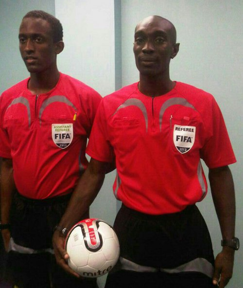 Photo: Referee Joel Davidson (right) and referee's assistant Caleb Wales might have gotten their wires crossed yesterday.