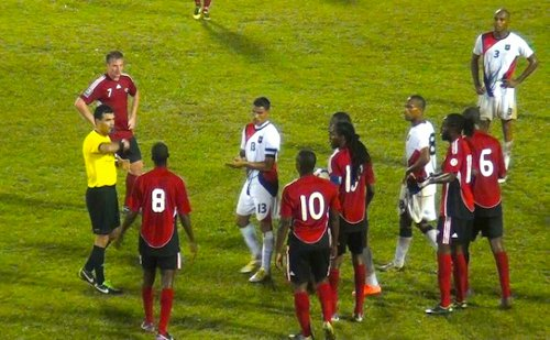 Photo: Belizean referee Irfan Basdemir (far left) is about to show the red card to Trinidad and Tobago substitute Devorn Jorsling (number 10). Midfielder Keon Daniel, at Jorsling's right, appears to be wearing the captain's armband. (Courtesy TTFF Media)