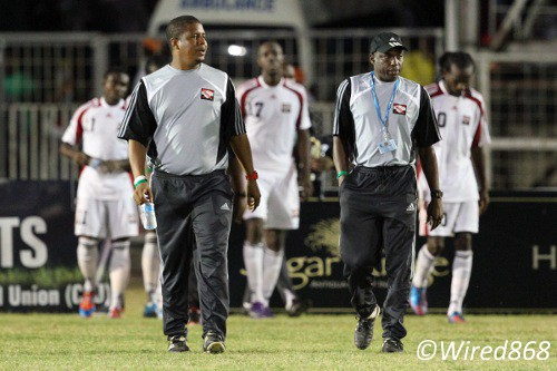 "Photo: Trinidad and Tobago national senior team football coach Hutson ""Barber"" Charles (second from right) and assistant coach Derek King (second from left) during the 2012 Caribbean Cup finals. (Courtesy Allan V. Crane/Wired868)"