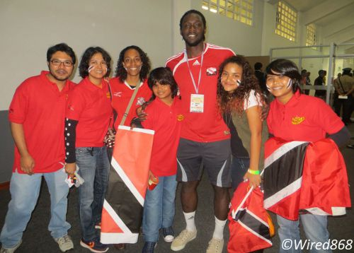 "Photo: Trinidad and Tobago and Stoke City striker Kenwyne Jones poses with some ""Trinbago"" supporters in Lima. (Courtesy Juliet Solomon/Wired868)"