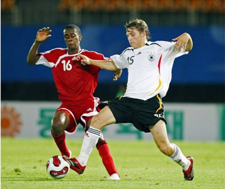 Photo: Marcus Joseph (left) tackles German midfielder Tony Jantschke during the 2007 FIFA Under-17 World Cup. Jantschke is now in his fifth professional season with Bundesliga club, Borussia Mönchengladbach. (Courtesy FIFA.com)